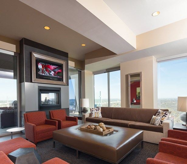 high rise apartments austin - SkyHouse Austin Indoor/outdoor lounge with fireplace TV and Wi-Fi