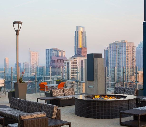 Rainey Street apartments for rent - SkyHouse Austin Rooftop deck with firepit and views of downtown