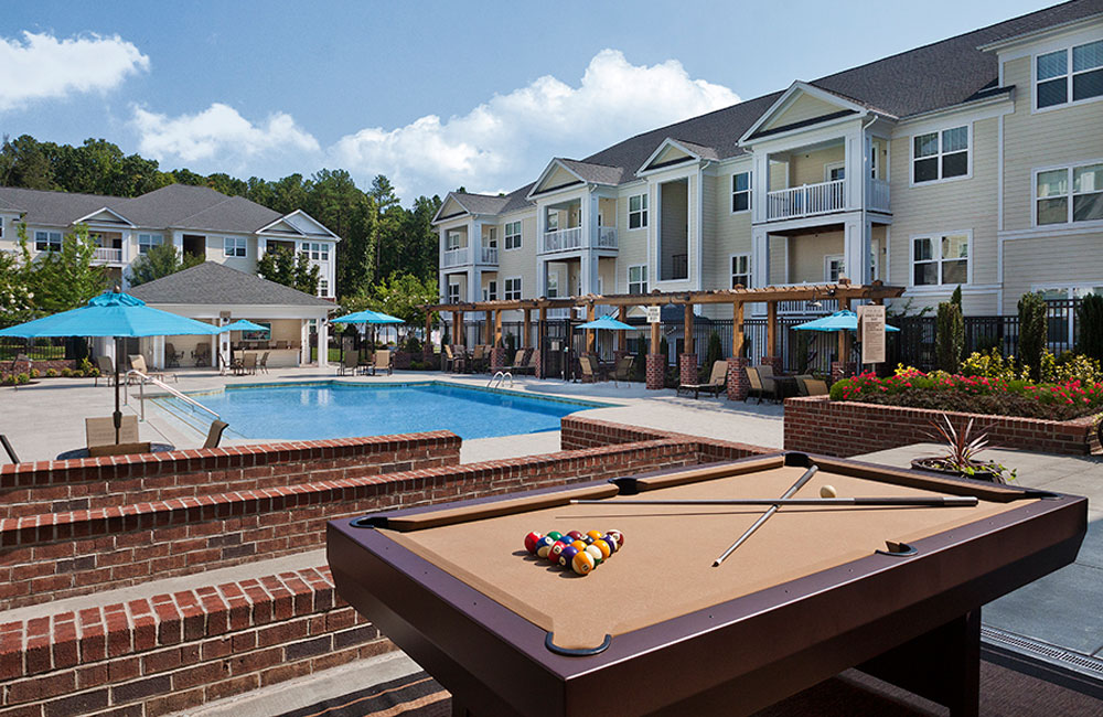 Chancery Village Resort style swimming pool with billiards table Cary NC