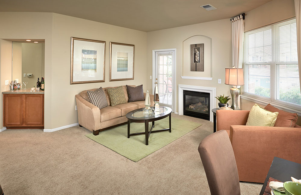 Meadows At Meridian Spacious Living room with fireplace Parker CO