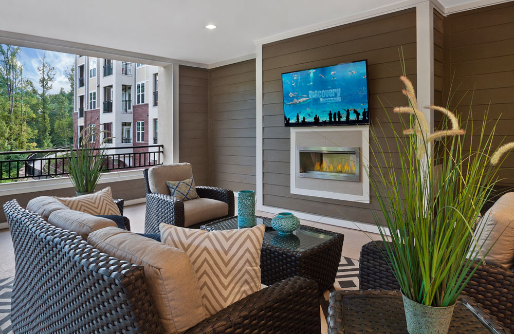 Marshall Park apartments for rent in Raleigh, NC - Covered lounge seating with flat screen TV Raleigh NC - Central Raleigh - Red Hat
