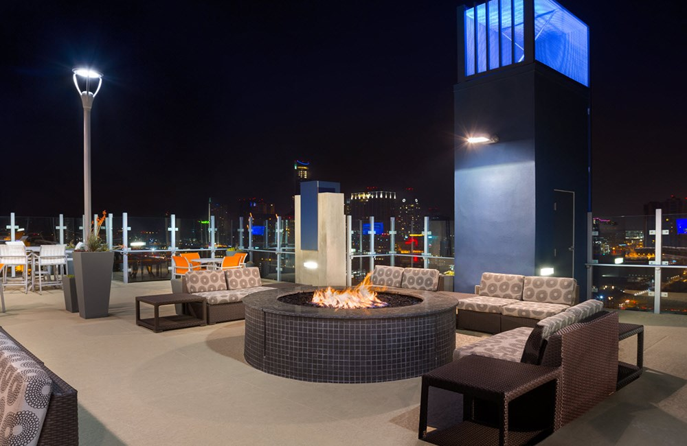 Rooftop Lounge and Fire Pit at Night at SkyHouse Austin
